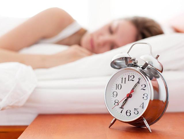 woman sleeping alarm clock