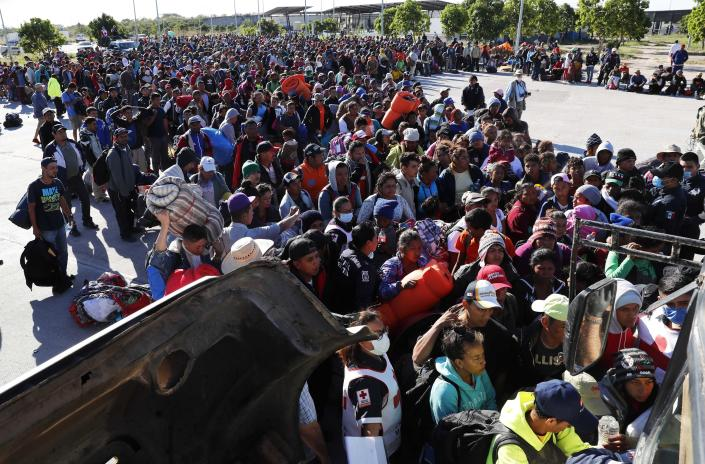 <p>Migrants traveling with a caravan hoping to reach the U.S. border, wait in line to board buses in La Concha, Mexico, Wednesday, Nov. 14, 2018. Buses and trucks are carrying some migrants into the state of Sinaloa along the Gulf of California and further northward into the border state of Sonora. The bulk of the main caravan appeared to be about 1,100 miles from the border, but was moving hundreds of miles per day. (Photo: Marco Ugarte/AP) </p>