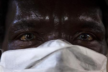 A patient with HIV and tuberculosis wears a mask while awaiting consultation at the Ubuntu clinic in Cape Town