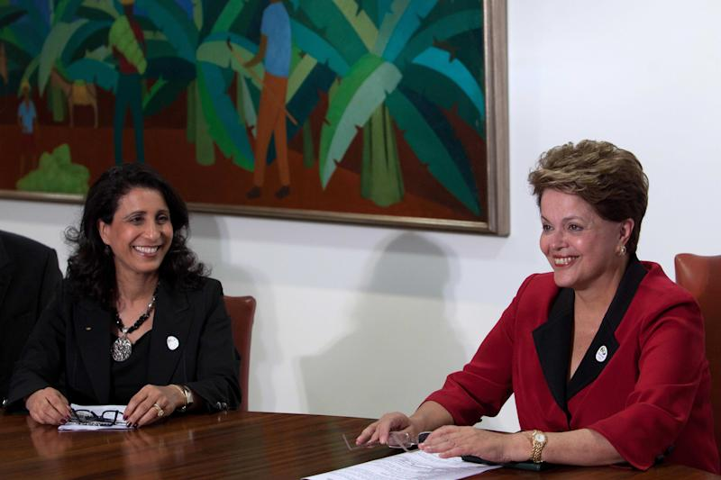 Nawal El Moutawakel, head of the International Olympic Committee (IOC) Evaluation Commission, left, and Brazil's President Dilma Rousseff smile during a meeting at the Planalto palace in Brasilia, Brazil, Thursday, March 8, 2012. Members of the IOC commission visited Brazil in order to monitoring the preparations for 2016 Rio Games.  (AP Photo/Eraldo Peres)