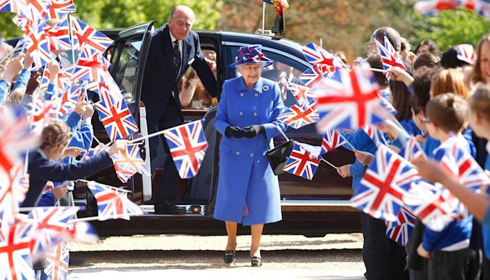 <p>Queen Elizabeth looked particularly patriotic in cobalt blue when she visited the Sainsbury Laboratory for Plant Sciences in the University of Cambridge Botanic Garden with Prince Philip on April 27, 2011.</p>