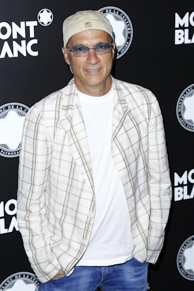 "FILE - This Oct. 2, 2012 file photo shows chairman of Interscope-Geffen A&M Jimmy Iovine attends Montblanc de la Culture Arts Patronage Award honoring Quincy Jones in Los Angeles. Iovine and Luke Wood were so moved by the ""Muscle Shoals"" documentary, they're putting up money to make sure the unique spirit of the Alabama music haven lives on. The Beats Electronics officials are starting a program to refurbish and upgrade two historic studios in Muscle Shoals _ FAME Recording Studios and Muscle Shoals Sound Studio _ then will install education programs to train a new generation of producers, audio engineers and musicians. (Photo by Joe Kohen/Invision/AP, File)"