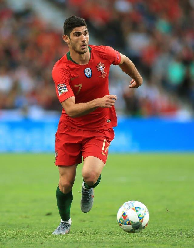 Goncalo Guedes runs forward with the ball in front of his feet