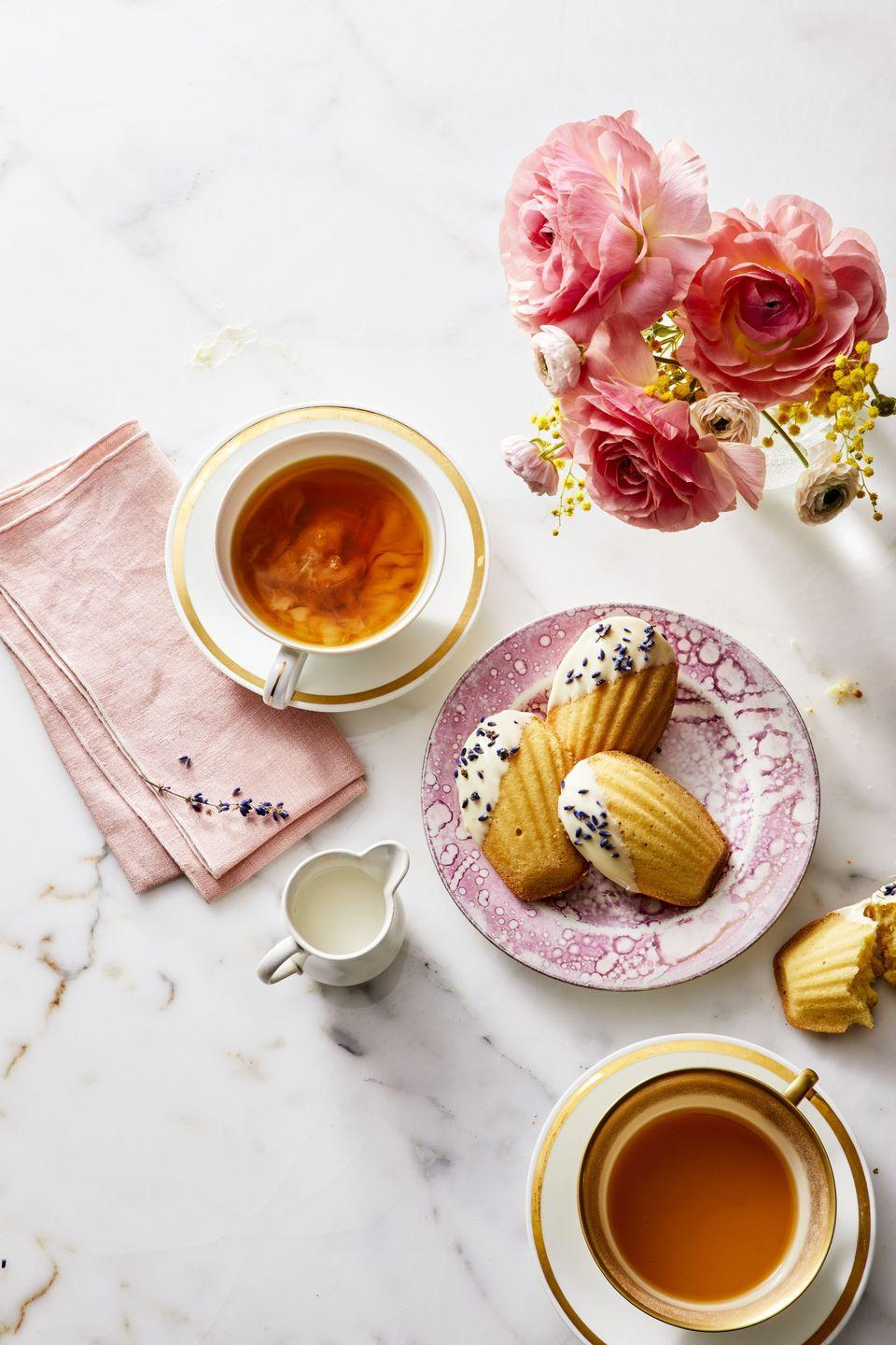 "<p>While you wait for the day that you can treat her to a Parisian adventure, make her these cake-like French treats. And while you're at it, brew her a cup of her favorite herbal tea to go with them.</p><p><em><a href=""https://www.goodhousekeeping.com/food-recipes/dessert/a27274891/white-chocolate-and-lavender-madeleines-recipe/"" rel=""nofollow noopener"" target=""_blank"" data-ylk=""slk:Get the recipe for White Chocolate and Lavender Madeleines »"" class=""link rapid-noclick-resp"">Get the recipe for White Chocolate and Lavender Madeleines »</a></em> <strong><br></strong></p><p><strong>RELATED:</strong> <a href=""https://www.goodhousekeeping.com/holidays/mothers-day/g676/mothers-day-brunch-recipes/"" rel=""nofollow noopener"" target=""_blank"" data-ylk=""slk:40 Best Mother's Day Brunch Recipes Mom Will Love"" class=""link rapid-noclick-resp"">40 Best Mother's Day Brunch Recipes Mom Will Love</a></p>"