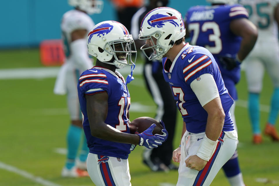 Buffalo Bills quarterback Josh Allen (17) congratulates wide receiver John Brown (15) after Brown scored a touchdown. (AP Photo/Lynne Sladky)