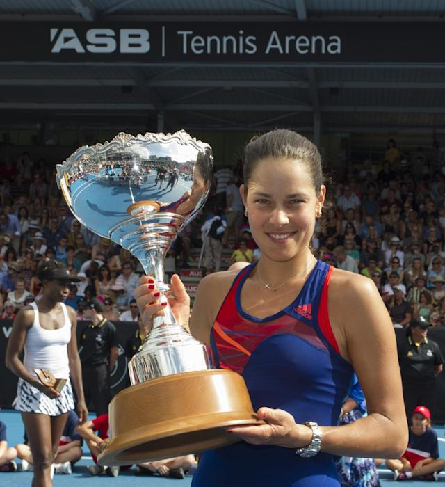 Serbia's Ana Ivanovic holds the trophy after defeating Venus Williams of the U.S. in the singles final at the ASB Classic women's tennis tournament, at ASB Tennis Arena, in Auckland, New Zealand, Saturday, Jan. 4, 2014. (AP Photo/SNPA, David Rowland)