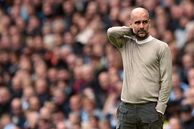 Guardiola dejected as Wolves lead at the Etihad (Photo by OLI SCARFF/AFP via Getty Images)