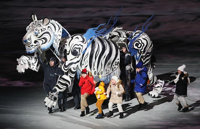 <p>Five children walked alongside a white tiger, the protector of Korea and the mascot of the Pyeongchang Games. </p>