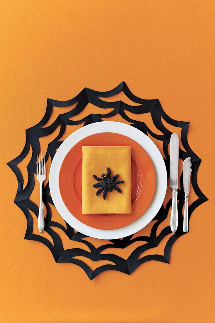"""<p>Serve up Halloween-themed dishes in style with the help of this spiderweb placemat craft. </p><p><strong><em><a href=""""https://www.womansday.com/home/crafts-projects/how-to/a5903/halloween-craft-how-to-spiderweb-placemat-123822/"""" rel=""""nofollow noopener"""" target=""""_blank"""" data-ylk=""""slk:Get the Spiderweb Placemat tutorial"""" class=""""link rapid-noclick-resp"""">Get the Spiderweb Placemat tutorial</a>. </em></strong></p><p><a class=""""link rapid-noclick-resp"""" href=""""https://www.amazon.com/Colorbok-74293-12x12in-Smooth-Cardstock/dp/B07GVRW1L2?tag=syn-yahoo-20&ascsubtag=%5Bartid%7C10070.g.2488%5Bsrc%7Cyahoo-us"""" rel=""""nofollow noopener"""" target=""""_blank"""" data-ylk=""""slk:SHOP BLACK CONSTRUCTION PAPER"""">SHOP BLACK CONSTRUCTION PAPER</a></p>"""