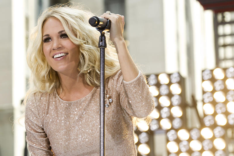 "FILE - In this Aug. 15, 2012 file photo, Carrie Underwood performs on NBC's ""Today"" show in New York. Underwood starts the 50-plus-date U.S. leg of her ""Blown Away"" tour Friday, Sept. 14, 2012. (Photo by Charles Sykes/Invision/AP, File)"