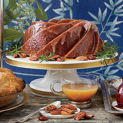 """<p><strong>Recipe: <a href=""""https://www.southernliving.com/syndication/pecan-spice-cake-glaze"""" rel=""""nofollow noopener"""" target=""""_blank"""" data-ylk=""""slk:Pecan Spice Cake with Caramel-Rum Glaze"""" class=""""link rapid-noclick-resp"""">Pecan Spice Cake with Caramel-Rum Glaze</a></strong></p> <p>For such a spectacular result, this warm cake comes together quickly. For a thicker glaze, add the whole 1 1/3 cups powdered sugar, whisking constantly, as the glaze begins to cool in the pan. For a sheer, saucy glaze, use less powdered sugar.</p>"""