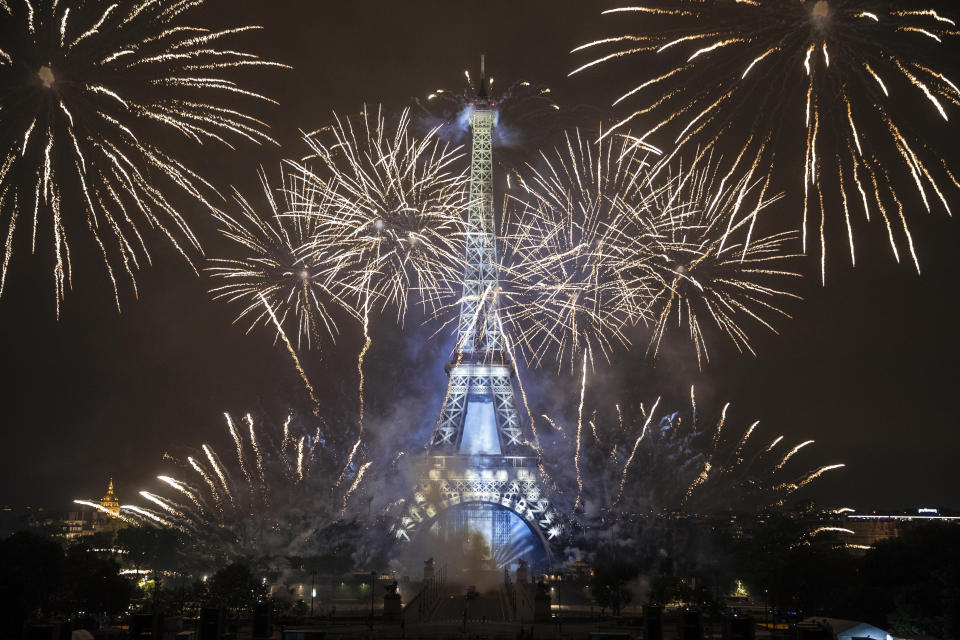 Fireworks illuminate the Eiffel Tower in Paris during Bastille Day celebrations late Wednesday, July 14, 2021. France has celebrated its national holiday with thousands of troops marching in a Paris parade and traditional parties around the country. Last year's Bastille Day events were scaled back because of virus fears. (AP Photo/Lewis Joly)
