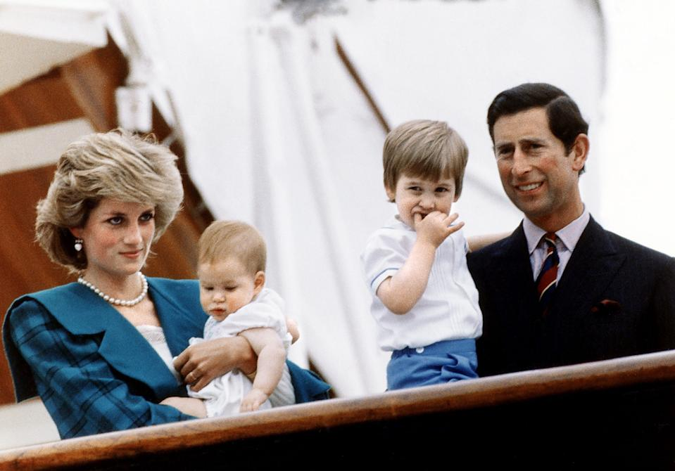Princess Diana and Prince Charles pose with their sons Princes Harry and William on board royal yacht Britannia during their visit to Venice, Italy, 6th May 1985. (Photo by Mirrorpix/Getty Images)