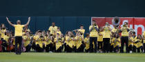 Members of the Oakland Unified School District honor band kneel while playing the national anthem before the start of the Oakland Athletics game on Tuesday, Sept. 20, 2016, in Oakland, Calif. (Aric Crabb/Bay Area News Group)