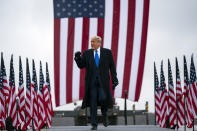 President Donald Trump arrives at Capital Region International Airport for a campaign rally, Tuesday, Oct. 27, 2020, in Lansing, Mich. (AP Photo/Evan Vucci)