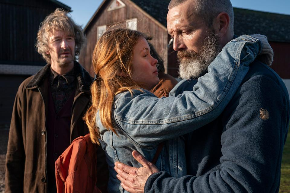 """Mads Mikkelsen (right) stars as a soldier who comes home to take care of his daughter (Andrea Heick Gadeberg) and exact vengeance on the street gang responsible for his wife's death in """"Riders of Justice."""""""