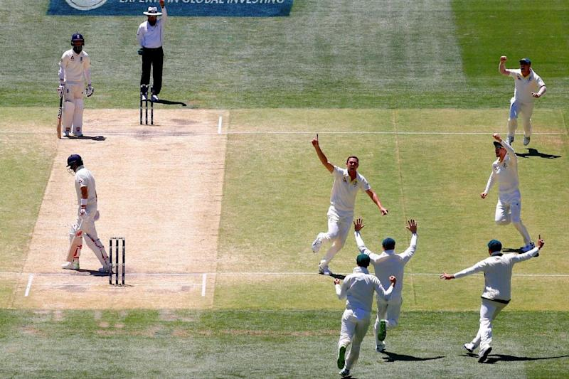 Australia celebrate the key wicket of Root in Adelaide (REUTERS/David Gray)