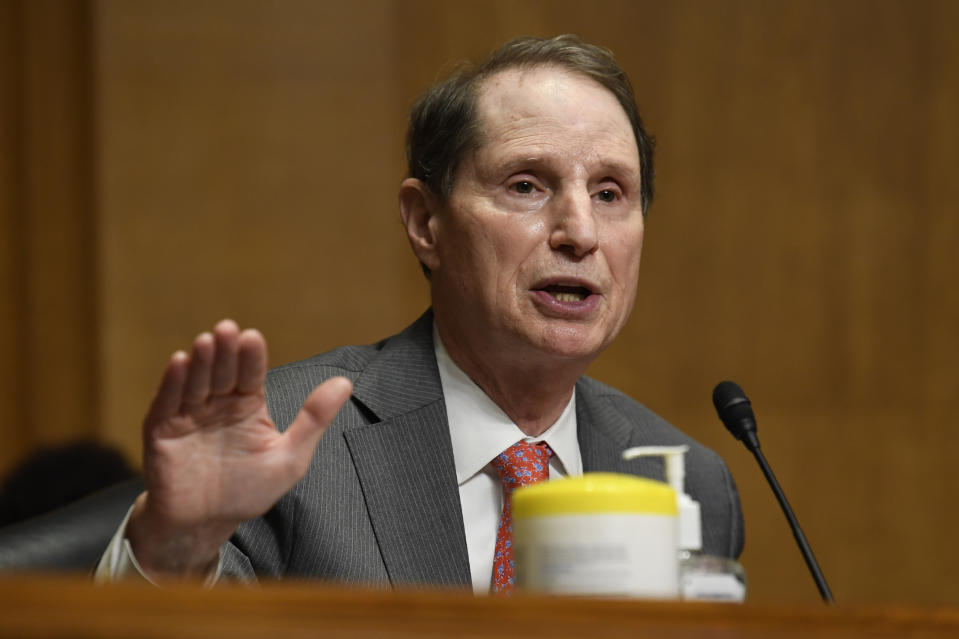 Sen. Ron Wyden, D-Ore., questions Internal Revenue Service Commissioner Charles Rettig at a Senate Finance Committee hearing on Capitol Hill in Washington, Tuesday, June 30, 2020, on the 2020 filing season and COVID-19 recovery. (AP Photo/Susan Walsh, Pool)