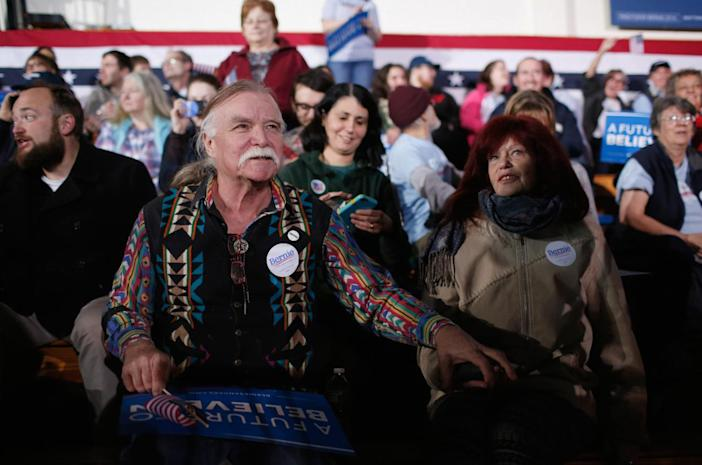 <p>Bernie Sanders supporters John Gurney and Lisette Lux wait for the Democratic presidential candidate's New Hampshire primary-night watch party to begin on Feb. 9, 2016, in Concord, N.H. (Win McNamee/Getty Images)</p>