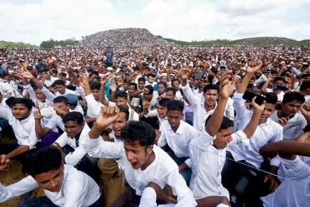 FILE PHOTO: Rohingya refugees shout slogans as they gather to mark the second anniversary of the exodus at the Kutupalong camp in Cox's Bazar