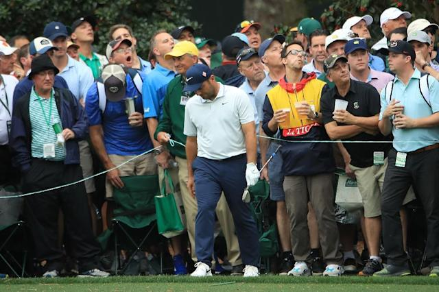 Italy's Francesco Molinari reacts after his third shot at the 15th hole hits the water in the final round of the Masters at Augusta National (AFP Photo/Andrew Redington)