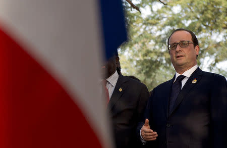 French President Francois Hollande pays tribute at the tomb of Leopold Sedar Senghor, a former president of Senegal at a cemetery in Bel Air, near Dakar