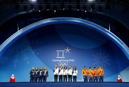 Medals Ceremony - Short Track Speed Skating Events - Pyeongchang 2018 Winter Olympics - Women's 3000 m - Medals Plaza - Pyeongchang, South Korea - February 21, 2018 - Gold medalists Shim Sukhee, Minjeong Choi, Kim Alang and Kim Yejin of South Korea, silver medalists Arianna Fontana, Lucia Peretti, Cecilia Maffei and Martina Valcepina of Italy, and bronze medalists Suzanne Schulting, Yara Van Kerkhof, Lara van Ruijven, Jorien ter Mors of the Netherlands on the podium. REUTERS/Eric Gaillard