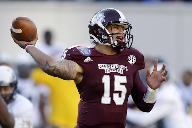 Mississippi State quarterback Dak Prescott passes against Rice in the first quarter of the Liberty Bowl NCAA college football game on Tuesday, Dec. 31, 2013, in Memphis, Tenn. (AP Photo/Mark Humphrey)