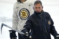 Boston Bruins head coach Bruce Cassidy instructs his players at the team's NHL hockey training camp, Monday, Jan. 4, 2021, in Boston. (AP Photo/Elise Amendola)