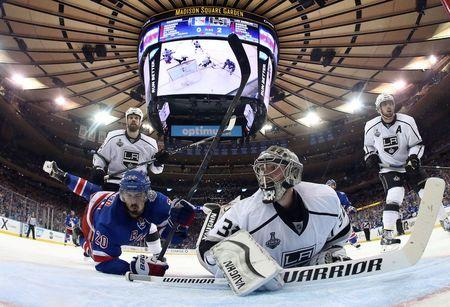 Jun 9, 2014; New York, NY, USA; Los Angeles Kings goalie Jonathan Quick (32) and New York Rangers left wing Chris Kreider (20) look back for the puck as they collide during the second period in game three of the 2014 Stanley Cup Final at Madison Square Garden. Mandatory Credit: Bruce Bennett/Pool Photo via USA TODAY Sports