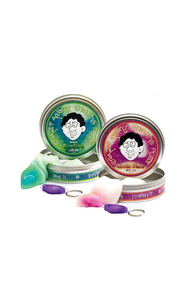 """<p>$15</p><p><a rel=""""nofollow"""" href=""""https://www.uncommongoods.com/product/black-light-putty"""">BUY NOW</a></p><p>This new age version of an old school favorite will let him doodle on the moldable putty. Then, he can bring it to life using the included black light keychain.</p>"""