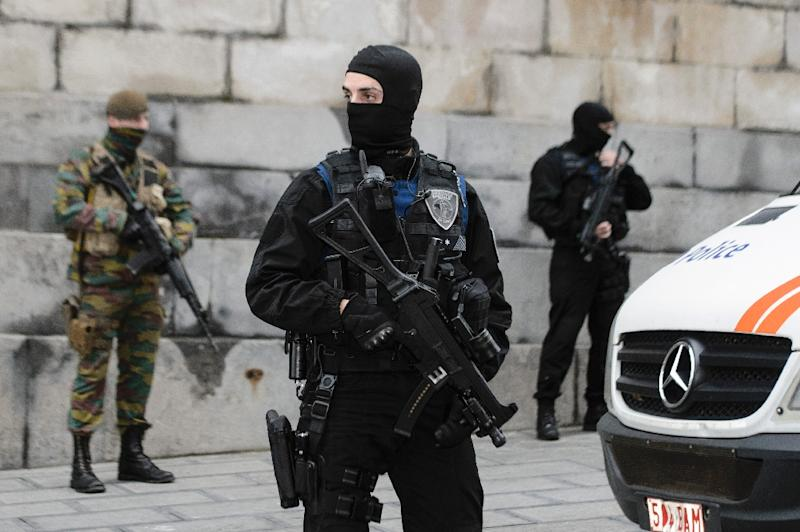 Belgian police officers and soldiers stand guard outside the Palace of Justice in Brussels during the appearance of two individuals arrested in connection with the November 13 attacks in Paris, on November 20, 2015