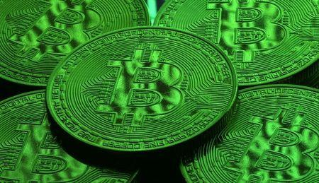 Virtual currency Bitcoin tokens are seen in this illustration picture