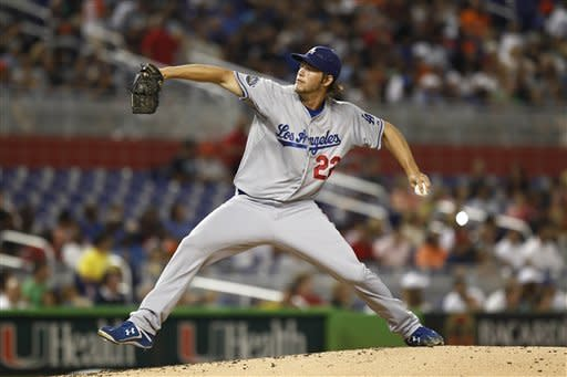 Los Angeles Dodgers starter Clayton Kershaw pitches to the Miami Marlins during the second inning of a baseball game in Miami, Friday, Aug. 10, 2012. (AP Photo/J Pat Carter)