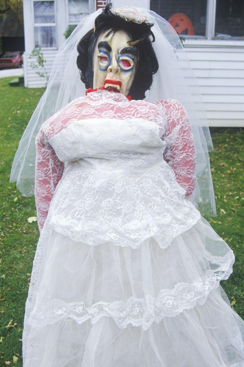 "<p>A scary bride sits on a lawn in New England in the early 1990s, ready to ward off any Halloween pranksters. </p><p><strong>BUY</strong>: <a href=""https://www.amazon.com/Lifesize-Haunting-Zombie-Halloween-Decoration/dp/B074CPNZN4"" rel=""nofollow noopener"" target=""_blank"" data-ylk=""slk:Zombie Bride"" class=""link rapid-noclick-resp"">Zombie Bride</a> ($70, Amazon) </p>"