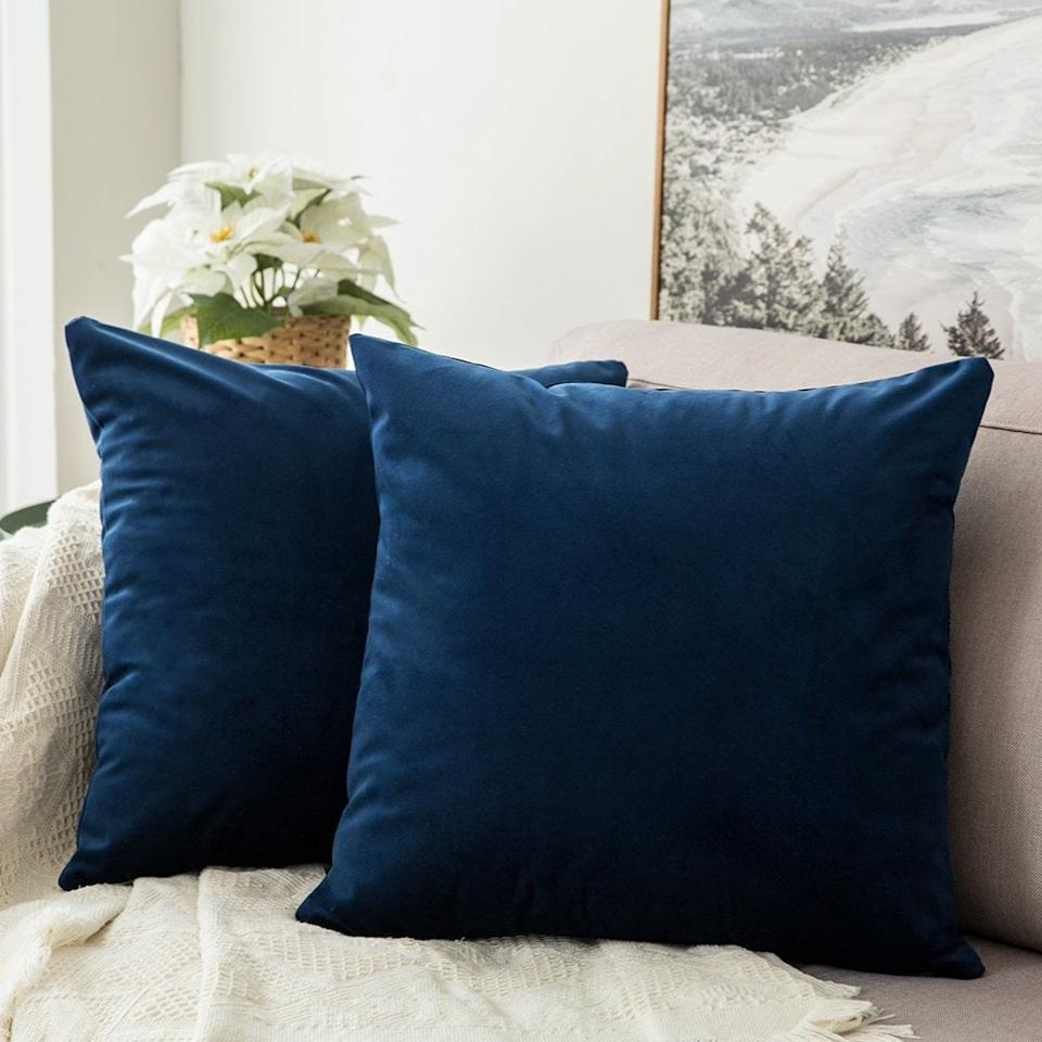 """<p>You can't go wrong with these <product href=""""https://www.amazon.com/MIULEE-Velvet-Decorative-Cushion-Bedroom/dp/B076LWHV2Z/ref=sr_1_5?keywords=throw+pillows&amp;qid=1572454427&amp;sr=8-5"""" target=""""_blank"""" class=""""ga-track"""" data-ga-category=""""Related"""" data-ga-label=""""https://www.amazon.com/MIULEE-Velvet-Decorative-Cushion-Bedroom/dp/B076LWHV2Z/ref=sr_1_5?keywords=throw+pillows&amp;qid=1572454427&amp;sr=8-5"""" data-ga-action=""""In-Line Links"""">Miulee Velvet Soft Soild Decorative Square Throw Pillow Covers</product> ($13 for two). They come in so many different colors!</p>"""