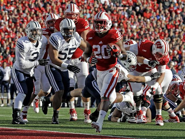 Wisconsin's James White (20) breaks into the end zone for a touchdown during the first half of an NCAA college football game against Brigham Young, Saturday, Nov. 9, 2013, in Madison, Wis. (AP Photo/Morry Gash)