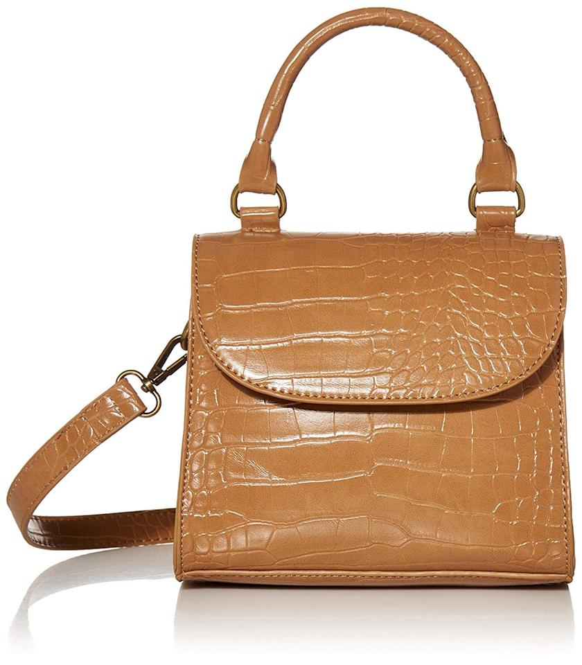 "<p>You can also get this <a href=""https://www.popsugar.com/buy/Drop-Diana-Top-Handle-Crossbody-Bag-548632?p_name=The%20Drop%20Diana%20Top-Handle%20Crossbody%20Bag&retailer=amazon.com&pid=548632&price=40&evar1=fab%3Aus&evar9=47213733&evar98=https%3A%2F%2Fwww.popsugar.com%2Ffashion%2Fphoto-gallery%2F47213733%2Fimage%2F47213929%2FDrop-Diana-Top-Handle-Crossbody-Bag&list1=shopping%2Camazon%2Caccessories%2Cbags%2Chandbags%2Caffordable%20shopping&prop13=mobile&pdata=1"" rel=""nofollow"" data-shoppable-link=""1"" target=""_blank"" class=""ga-track"" data-ga-category=""Related"" data-ga-label=""https://www.amazon.com/Drop-Womens-Diana-Handle-Crossbody/dp/B07ZXPWZRS/ref=sr_1_20?dchild=1&amp;qid=1581538798&amp;rnid=7147440011&amp;s=apparel&amp;sr=1-20"" data-ga-action=""In-Line Links"">The Drop Diana Top-Handle Crossbody Bag</a> ($40) in black.</p>"