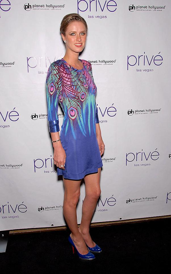 "A frail-looking Nicky Hilton failed to impress upon arriving at Planet Hollywood's Prive nightclub in this putrid peacock cocktail frock from the Matthew Williamson for H&M collection. Bruce Gifford/<a href=""http://www.filmmagic.com/"" target=""new"">FilmMagic.com</a> - April 11, 2009"