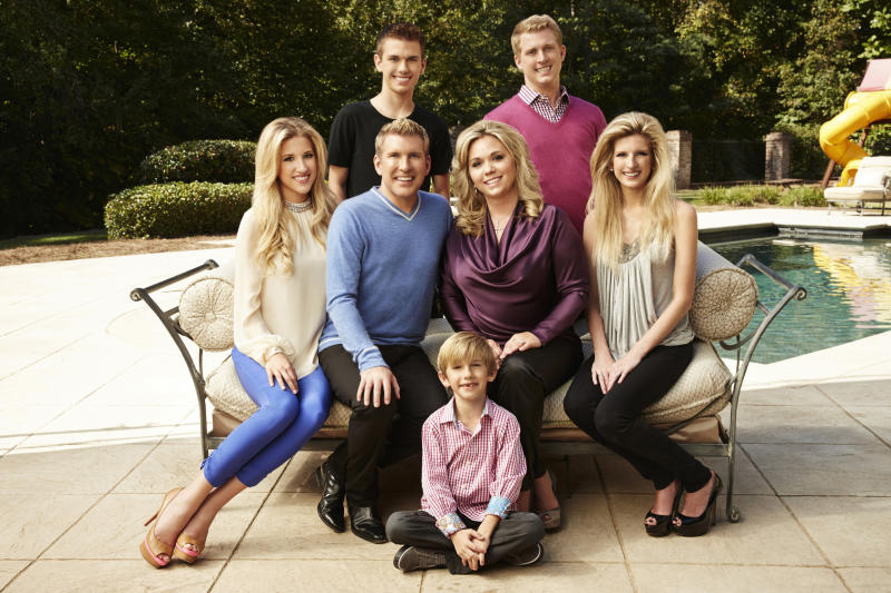 CHRISLEY KNOWS BEST -- Season:1 -- Pictured: (l-r) Savannah Chrisley, Todd Chrisley, Chase Chrisley, Grayson Chrisley, Julie Chrisley, Kyle Chrisley, Lindsie Chrisley Campbell -- (Photo by: Tommy Garcia/USA Network/NBCU Photo Bank via Getty Images)