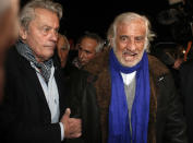 FILE - In this Nov. 17, 2017 file photo, French actors Alain Delon, left, and Jean-Paul Belmondo arrive for the inauguration of a giant Ferris wheel, in Paris. French New Wave actor Jean-Paul Belmondo has died, according to his lawyer's office on Monday Sept. 6, 2021. (AP Photo/Thibault Camus, File)