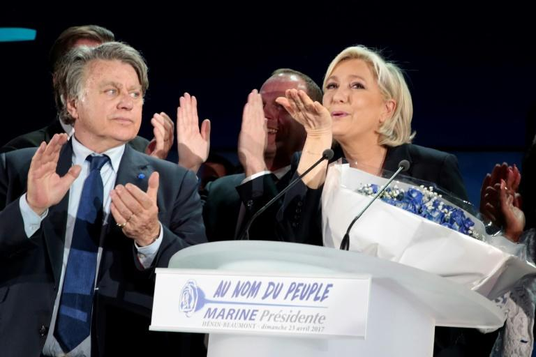 French far-right leader Marine Le Pen celebrates after projections show she has got through to the second round of the presidential election