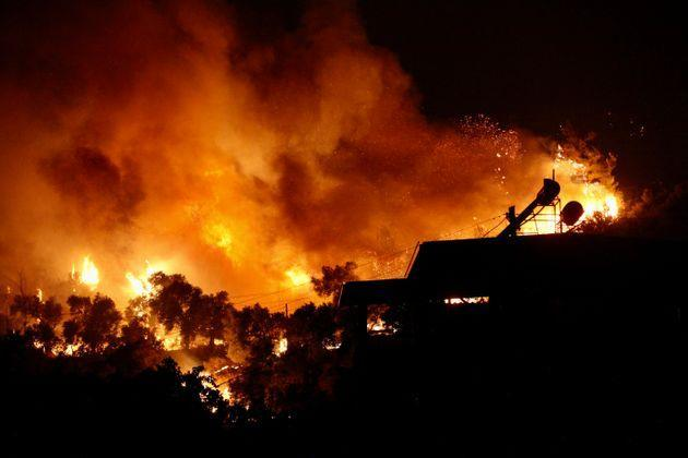A picture taken on August 3, 2021 shows flames rising from a fire spreading in the Aegean coast city of Oren, near Milas (Photo: STR via Getty Images)