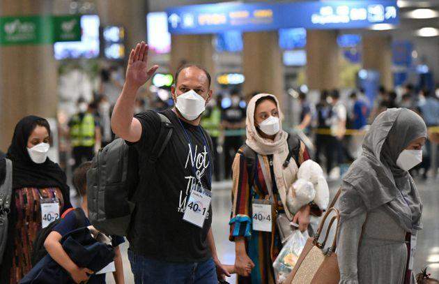 Afghan evacuees arrive at Incheon International Airport outside Seoul on August 26, 2021, following their departure from Kabul via Pakistan (Photo: JUNG YEON-JE via Getty Images)