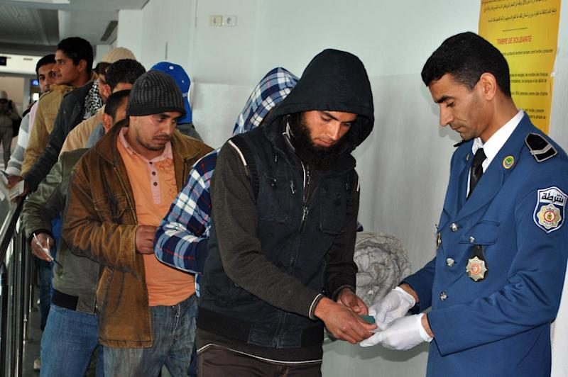 Egyptians, who were formerly residing in Libya, have their documents checked by Tunisian customs at Djerba airport on the Tunisian-Libyan border, before their departure for Cairo, on February 23, 2015 (AFP Photo/Fethi Nasri)