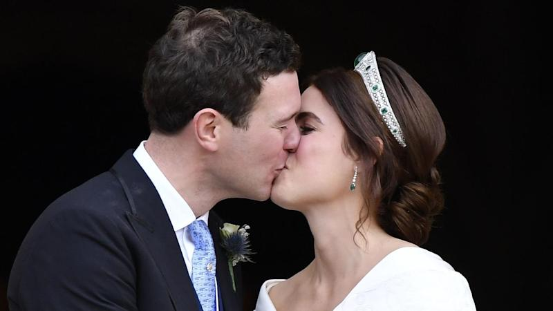 The royal couple tentatively performed the kisses for the cameras on the steps of St George's Chapel