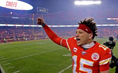 Kansas City Chiefs quarterback Patrick Mahomes celebrates as he comes off the field after an NFL divisional playoff football game against the Houston Texans, Sunday, Jan. 12 - Credit: AP