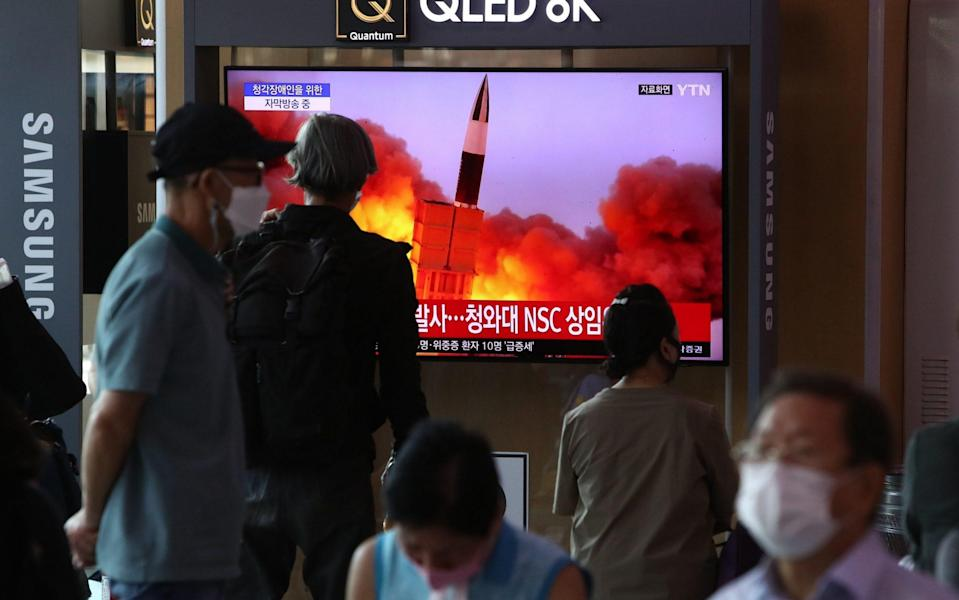 People in Seoul watch a TV showing the latest North Korean missile launch - Chung Sung-Jun/Getty Images AsiaPac