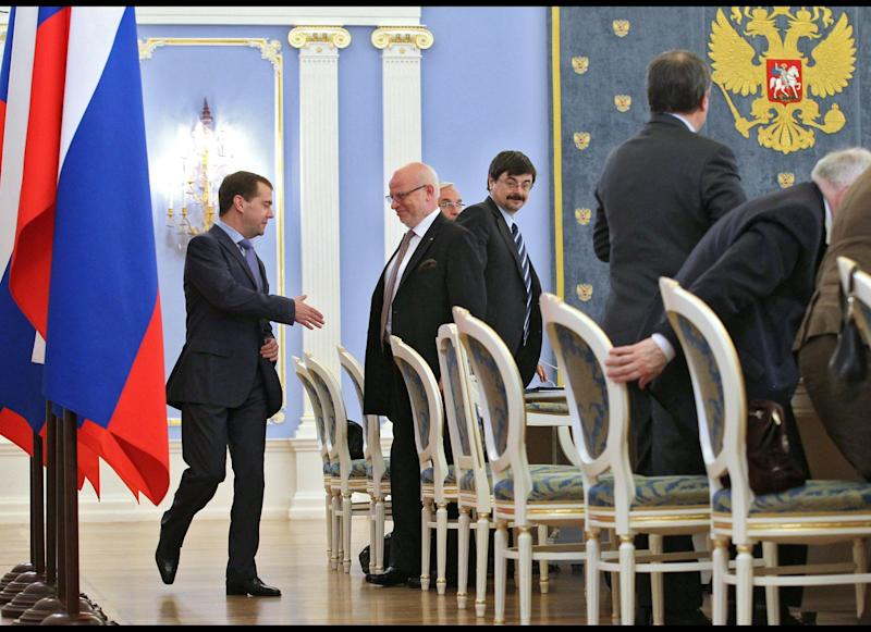 Russian President Dmitry Medvedev, left, shakes hands with Mikhail Fedotov, second left, the head of Russia's presidential human rights in the Gorki residence outside Moscow on Saturday, April 28, 2012. Medvedev's human rights council reported to him for the last time before he leaves office on May 7. The council has previously recommended that he pardon jailed oil tycoon Mikhail Khodorkovsky and could do so again, but Medvedev has made clear he will not do so unless Khodorkovsky acknowledges his guilt. (AP Photo/RIA-Novosti, Yekaterina Shtukina, Presidential Press Service)