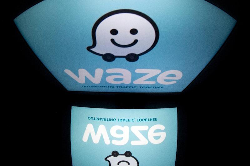 Waze, an Israeli copmany bought out by Google in 2013, is the largest community-based traffic and navigation app that shares real time traffic and road info (AFP Photo/LIONEL BONAVENTURE)